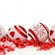 Christmas background with balls and red garlande in snow on white — Stock Photo #59588375