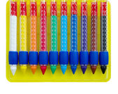 Ten colored wax crayons isolated over white — Stockfoto