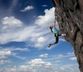 Female rock climber hanging over the abyss — Stock Photo