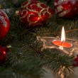 New Year Eve composition with burning candle and tree branch — Stock Photo #59862679