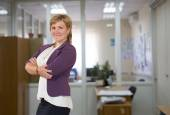 Mature female business executive at the office — Stock Photo