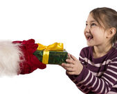 Santa Claus is giving a Christmas gift to child — Stock Photo