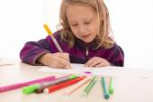 Child rapt with drawing — Stock Photo