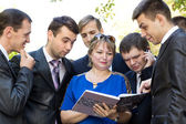 Lecturer reviews the student's homework — Stock Photo