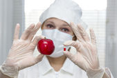 Nurse offers a choice of pill and apple — Stock Photo
