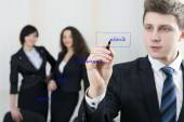 Young businessman draws chart for his team — Fotografia Stock
