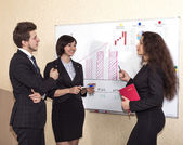 Discussion near the wall chart — Stock Photo