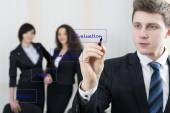 Young businessman draws chart for his team — Stock Photo