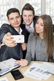 Happy co-workers makes SELFY — Stock Photo
