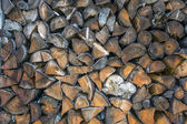 Stock of firewood at mountain guesthouse — Stock Photo