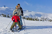 Family of three people learns skiing together — Stock Photo
