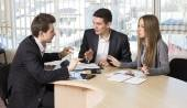 Group of three people having discussion — Stock Photo