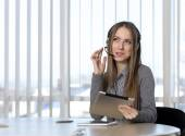 Dreaming female customer support officer — Stock Photo