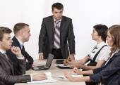Severe corporate manager is observing his business team — Foto de Stock