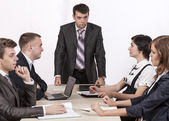 Severe corporate manager is observing his business team — Stock Photo