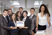 Business trainer and team of graduates — Stock Photo