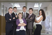 Business people stay with arms crossed — Stock Photo