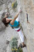 Happy smiling female climber — Stock Photo