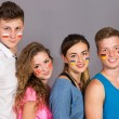 Four teenagers with flags drawn on the faces — Stock Photo #66939099