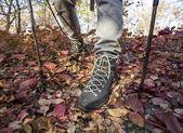 Close-up image of backpacker's feet dressed in heavy trekking boots — Stock Photo