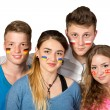 Four teenagers with flags drawn on the faces on white background — Stock Photo #68254545