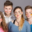 Four teenagers with flags drawn on the faces — Stock Photo #68254689