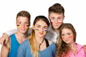Four teenagers with flags drawn on the faces on white background — Stockfoto