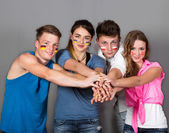 Team of young people joining hands — Stock Photo