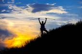 Mountain hiker in front of sunset — Stock Photo