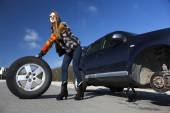 Female driver repairs car — Stock Photo