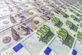 Large surface covered with US and European cash notes — Stock Photo