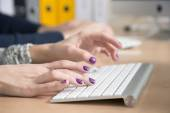 Female fingers typing on keyboard — Stock Photo