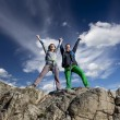 Group of two happy female climbers  celebrates the victory — Stock Photo #72118977