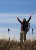 Female hiker with raised hands — Stock Photo