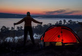Hiker, tent and sunrise — Stockfoto