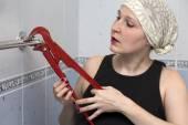 Female plumber doing household work — Stock Photo