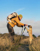 Hiker and dog — Stock Photo