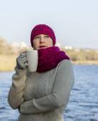 Lady in traditional northern scarf and sweeter — Stock Photo