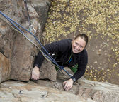 Smiling female climber and her ropes — Stock Photo