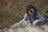 Brunette female climber with strand of hair — Stock Photo
