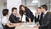 Energetic corporate manager instructs her team — Stock Photo