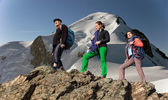 Team of climbers walks against alpine background — Stock Photo