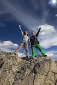 Group of two happy female climbers  celebrates the victory — Stock Photo