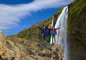 Group of climbers on the waterfall background — Stock Photo