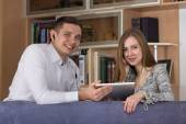 Young couple with electronic devise — Stock Photo