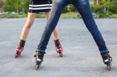 Bodies of two female skaters — Stock Photo