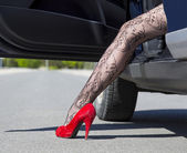 Leg of stylish female driver — Stock Photo