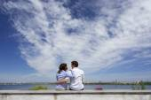 Young couple and cloudy sky — Stock Photo