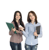 Two cute girls keeping large note pads — Stock Photo