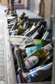 Entrance to cafe decorated with hundreds of beer bottle — Stock Photo